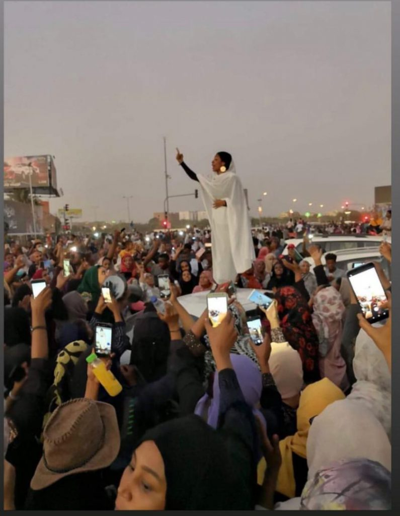 Lana Haroun captured 22-year-old Alaa Salah urging the protestors on. Across Sudan, the term 'Kandaka' (meaning Nubian Queen) has been used to demonstrate the strength of women and is a throwback to Ancient Sudanese history.